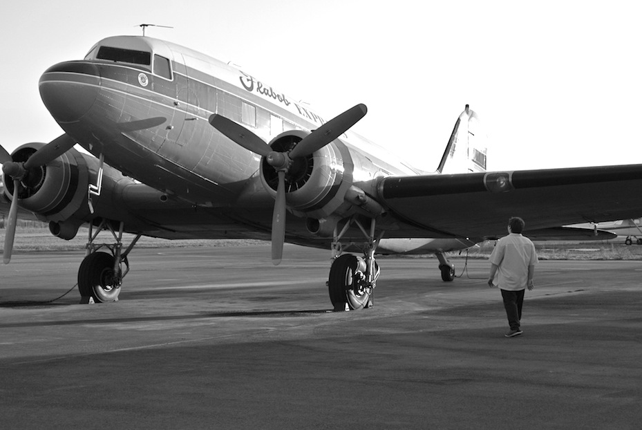 A black and white image of an old airplane in America.